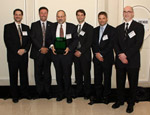 Ed Brown, CEO of the Ontario Telemedicine Network [centre, holding award], with his OTN team